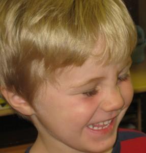 Joyful blonde boy