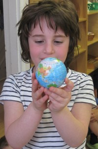 The world is in your hands. Young Masters Little Wisdom Discovery Program