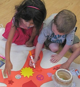 Children working together. Young Masters Little Wisdom Discovery Program