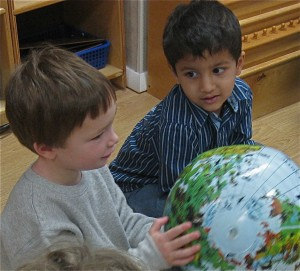 Two boys with globe